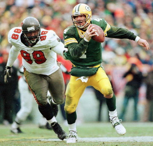 Sapp chases down Favre for one of his 3 sacks in the 1998 NFC Divisional Playoff in Lambeau.