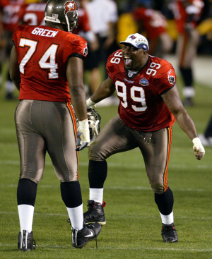 Sapp was a larger than life defensive tackle that Tony Dungy built his defense around. Pictured here celebrating in Super Bowl XXXVII.