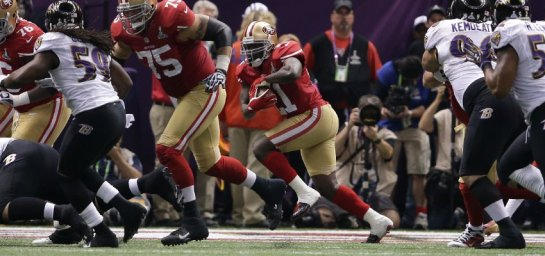 Frank Gore running a sweep during Super Bowl XLVII. He will have to abide by the new rule that mandates thigh and knee pads this year.