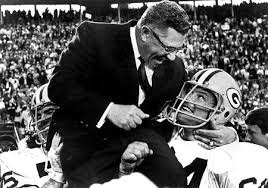 Vince Lombardi carried off the field by Jerry Kramer at the end of Super Bowl II
