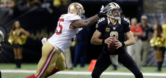 Drew Brees is about to be sacked by Ahmad Brooks of the 49ers.