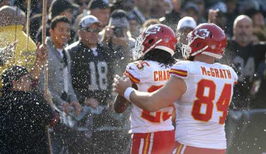 Cold beer thrown on him from Oakland fans couldn't cool down Jamaal Charles near record day.