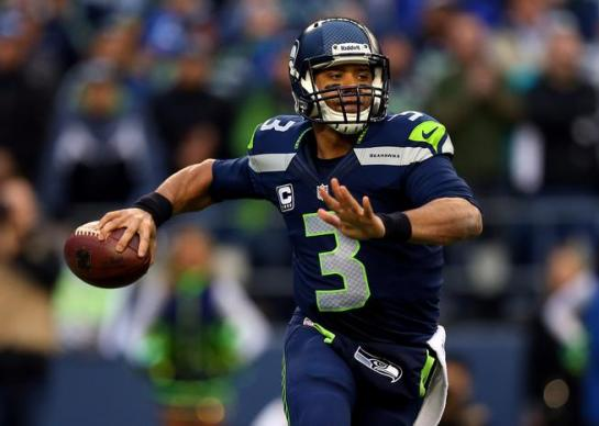 Russell Wilson keeps plays alive with his legs if they're not there initially.