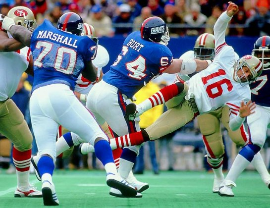 Jim Burt knocking Joe Montana out with a concussion in their 49-3 rout in the '86 playoffs.