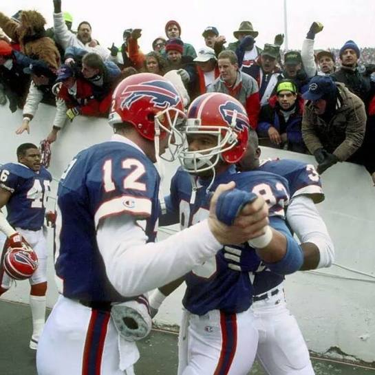 Kelly and Reed before taking the field in 1990.