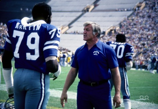 The late Stautner giving some gameday tips to the late Harvey Martin in 1978.