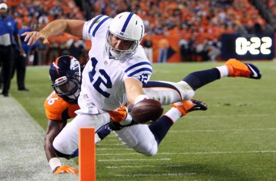 Luck scores in last year's playoff win in Denver.