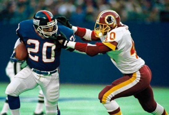 Morris stiff arms Alvin Walton in the 1986 NFC Championship Game