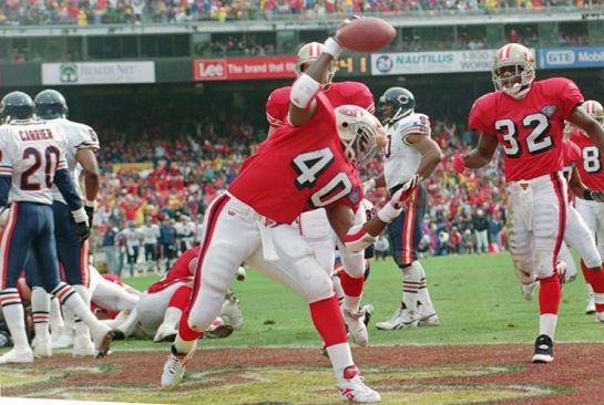 Floyd and Watters celebrate touchdown during their 44-15 demolition of Chicago in the '94 playoffs.