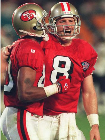 Young and Rice celebrate in Super Bowl XXIX.