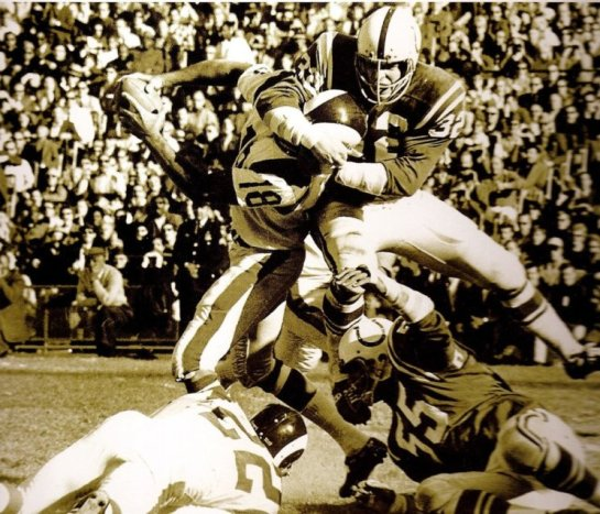 Mike Curtis nearly beheads Roman Gabriel.