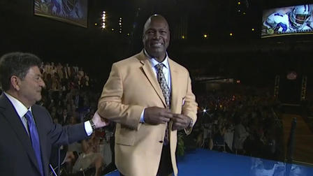 Charles Haley receives Hall of Fame gold jacket from Eddie DeBartolo
