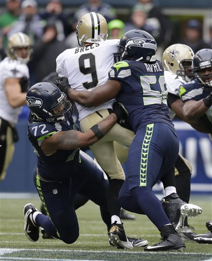 Michael Bennett & Cliff Avril sandwich Drew Brees amid the din of Qwest Field.