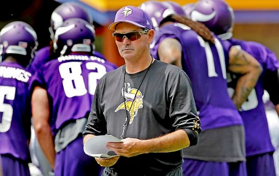 Minnesota Vikings head coach Mike Zimmer watches his team during an NFL mini camp in Eden Prairie, Minn., Tuesday, June 17, 2014. (AP Photo/Ann Heisenfelt)
