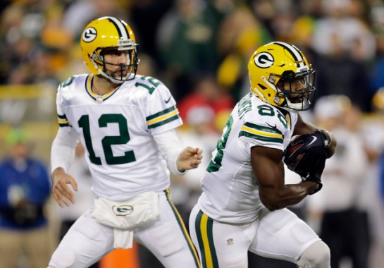 Oct 20, 2016; Green Bay, WI, USA;  Green Bay Packers quarterback Aaron Rodgers (12) hands off the ball to wide receiver Ty Montgomery (88) in the first quarter against the Chicago Bears at Lambeau Field. Mandatory Credit: Dan Powers/The Post-Crescent via USA TODAY Sports